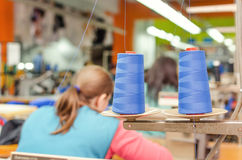 Industrial sewing. Woman industrial sewing textile industry Royalty Free Stock Image