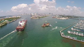 Industrial ship aerial view. Heavy cargo ship enters the Port of Miami seen from above