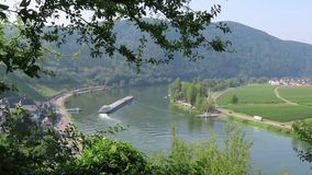 Industrial ship barge on Moselle river next to villages Beilstein and Ellenz Rhineland-Palatinate in Germany