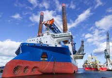 Industrial ship. Big ship on terminal in port of Frederikshavn.Windmill installing and repairing ship Royalty Free Stock Photo