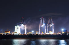 Industrial Shipping Port. At Night Stock Photos