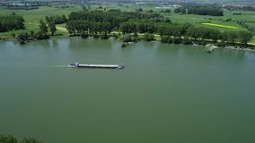 Industrial ships on Rhine river. Tracking shot in summer time, aerial view stock video