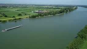 Industrial ships on Rhine river. Tracking shot in summer time, aerial view stock video footage