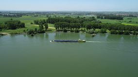 Industrial ships on Rhine river. Tracking shot in summer time, aerial view stock footage