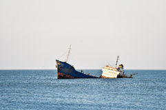 Industrial shipwreck abandoned into sea Royalty Free Stock Photography