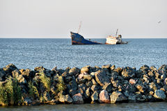 Industrial shipwreck abandoned into sea Royalty Free Stock Images