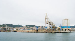 The industrial side of the harbor in Genoa, Italy. Stock Photography