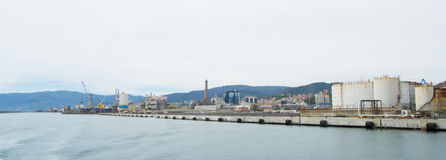 The industrial side of the harbor in Genoa, Italy. Royalty Free Stock Photos