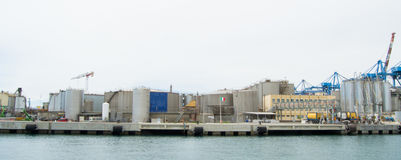 The industrial side of the harbor in Genoa, Italy. Royalty Free Stock Images