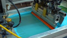 Industrial silk screen printing machine in action stock video