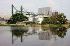 Industrial, silo near pond. Stock Photography