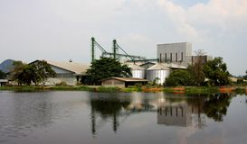 Industrial, silo near pond. Stock Photo