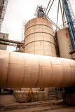 Industrial silo. S in a old rusty inviroment Stock Photography