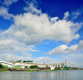 Industrial Silo Warehouse beside Tha Chin River Royalty Free Stock Photo