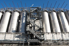 Industrial silos. Wide angle shot of factory silos and flight of stairs Royalty Free Stock Images