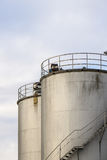 Industrial silos against the grey sky Stock Image