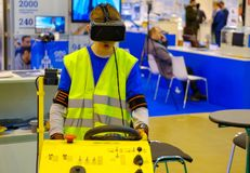 Industrial simulator of the airplane ladder driving is demonstrated at the exhibition Stock Photos