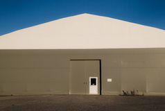 Industrial site building. Storage house at industrial site towards blue sky stock photography