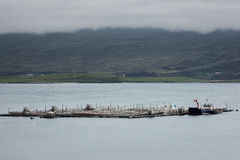 Industrial size fish pen on Loch Eriboll in Scotland. Stock Photography
