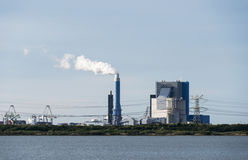 Industrial skyline with cranes and power plant in Holland europo Stock Photos