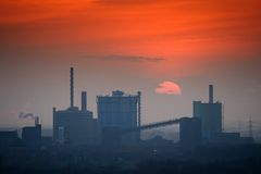 Industrial skyline at sunset. Industrial skyline with the setting Sun Royalty Free Stock Image