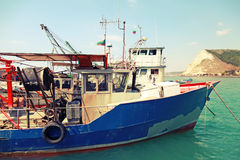 Industrial small fishing boats are moored in port Stock Photography
