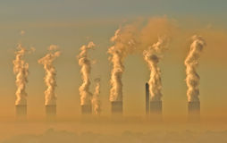 Industrial smog. Air pollution from an electricity generation plant Stock Photo