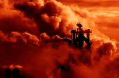 Industrial smoke. In sunset colors Stock Photos