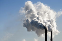 Industrial smoke from chimney. On blue sky Royalty Free Stock Photos