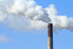 Industrial smoke from chimney on blue sky Royalty Free Stock Photography