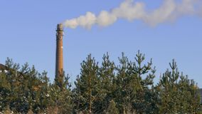Industrial smoke from chimney on blue sky stock video