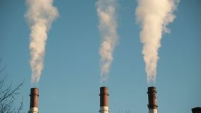 Industrial smoke from chimney on blue sky. Industrial smoke from chimney. Ecology problems stock footage
