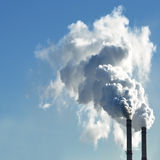 Industrial smoke from chimney on sky Stock Images