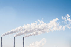 Industrial smoke comes out of a chimney Stock Image