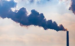 Industrial smoke from the plant pollutes the air.  Stock Photography