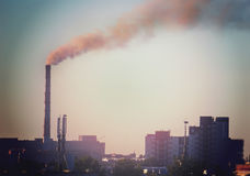 Industrial smoke stack of coal power plant in city Royalty Free Stock Photos