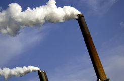 Industrial smoke stacks Stock Images