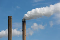 Industrial smoke stacks of a power plant. Royalty Free Stock Photos