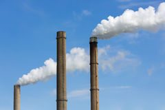Industrial smoke stacks of a power plant. Royalty Free Stock Image