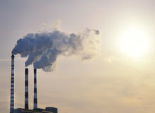 Industrial smoke on sunset Royalty Free Stock Photo