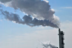 Industrial Smokestack. Emissions flow from a factory smokestack Royalty Free Stock Photos