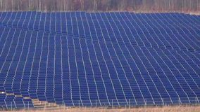 Industrial solar panel array zooming out to full view. Industrial photovoltaic solar panel array zooming out to full view - renewable energy topic stock video footage