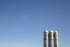 Industrial Stacks Blue Sky. Industrial, stacks, blue, sky, intrusion, metal, environment, industry, waste, pollution, skyline, gas, electricity, chemical royalty free stock images