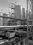 Industrial stainless steel pipe and holding tanks Stock Image