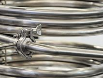 Industrial stainless steel pipe work. Coiled up royalty free stock images