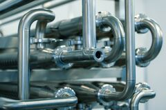 Free Industrial Stainless Steel Piping Connected By Special Nuts. Royalty Free Stock Photo - 179957285