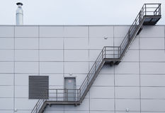 Industrial stairway on steel modern tile facade Stock Photos