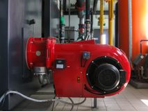 Gas boiIndustrial steam boilers in the boiler room, and powerful turbine gas burnerslers in gas boiler room. Industrial steam boilers in the boiler room, and stock photos