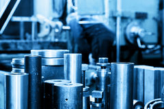 Industrial steel cylinders, pistons in workshop. Industry Royalty Free Stock Images