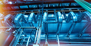 Industrial Steel pipelines and cables in blue tones stock images